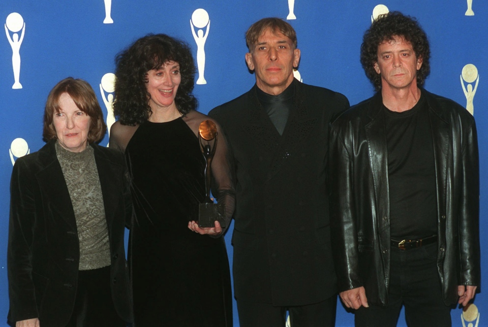 Members of the band the Velvet Underground, from left, Maureen Tucker; Martha Morrison, attending for her late husband, Sterling Morrison; John Cale and Lou Reed pose backstage after their induction into the Rock and Roll Hall of Fame in New York's Waldorf-Astoria Hotel, Jan. 17, 1996. (AP / Joe Tabacca)