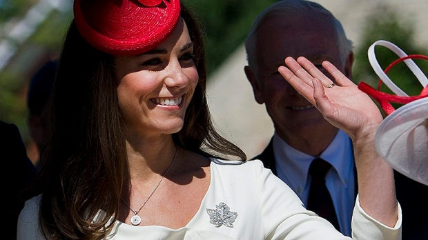 The Duchess of Cambridge waves to the crowd as she is accompanied by the Governor General's wife Sharon Johnston while arriving at the Museum of Civilization in Gatineau, Que., on Friday, July 1, 2011. (THE CANADIAN PRESS/Nathan Denette)