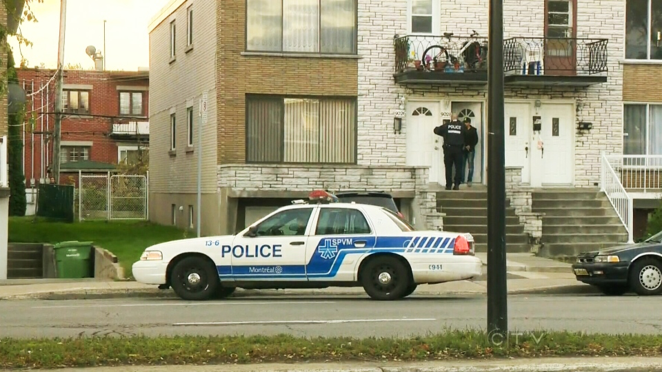 Police investigate a house in LaSalle, Que., believed to be linked to a suspicious package found at Trudeau Airport on Sunday, Oct. 27, 2013.