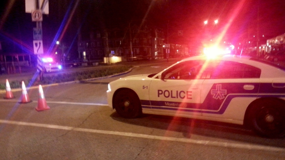 A Montreal police car blocks off a street in a residential area near Trudeau airport after the discovery of what authorities describe as a suspicious package at the airport's terminal earlier on Sunday Oct. 27, 2013. (Benjamin Shingle / THE CANADIAN PRESS)