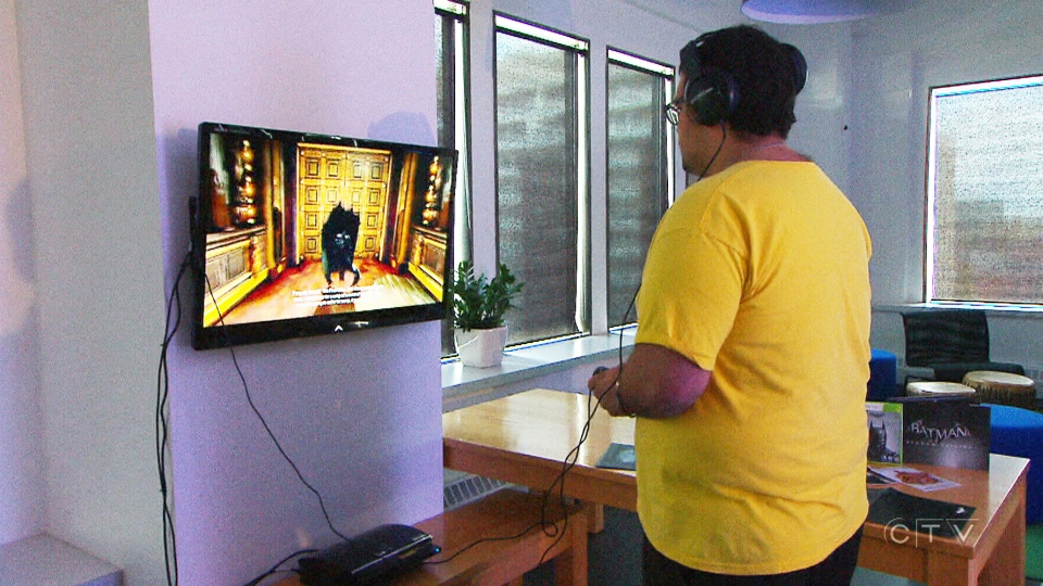 Gamer Salim Tannous, plays 'Batman: Archam Origins,' a game that was developed in Canada, on Sunday, Oct. 27, 2013.