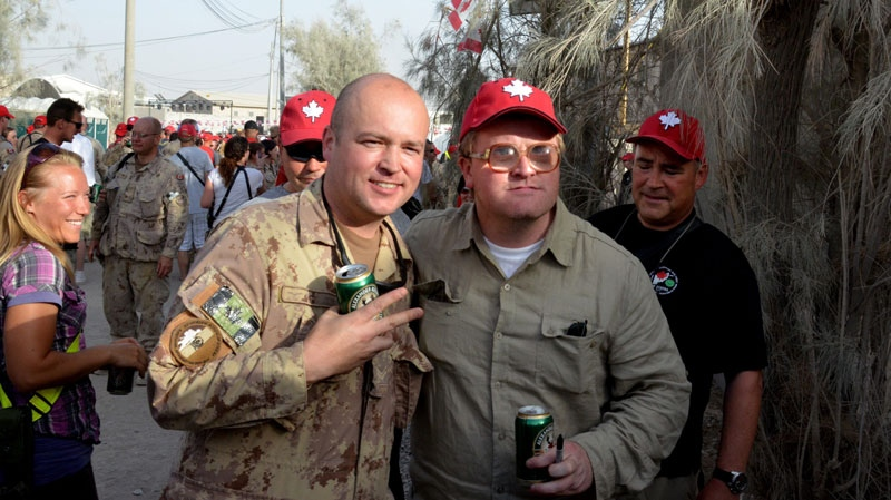 Comedian Mike 'Bubbles' Smith from the television show Trailer Park Boys (right) poses with a Canadian soldier during Canada Day celebrations at Kandahar Airfield on Fridsay July 1, 2011. (Murray Brewster / THE CANADIAN PRESS)