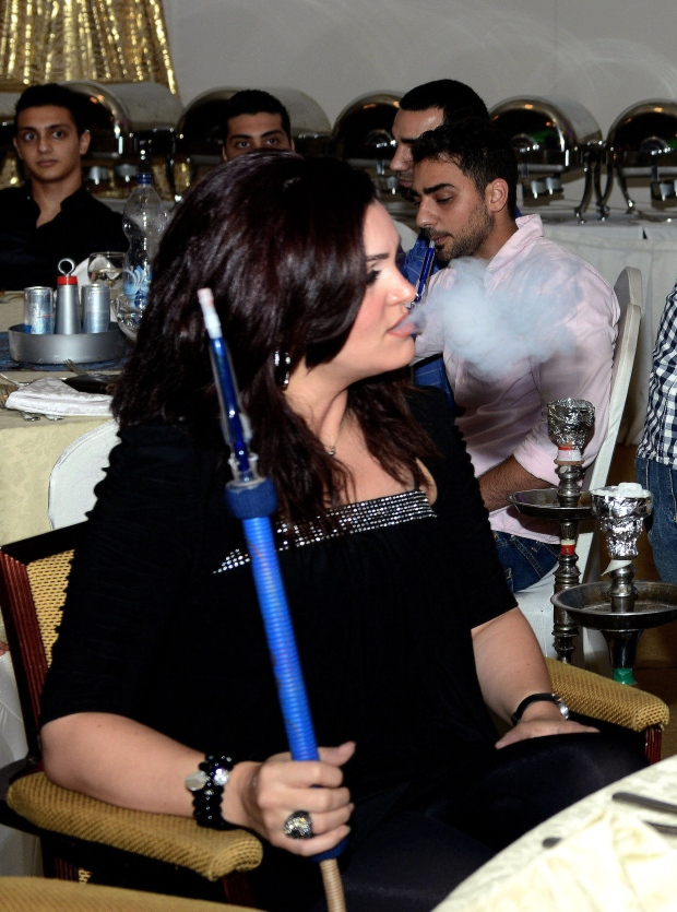 Woman in a shisha cafe