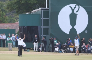 Phil Mickelson of the United States celebrates after his final putt on the 18th green during the final round of the British Open Golf Championship at Muirfield, Scotland, Sunday July 21, 2013. (AP / Scott Heppell)