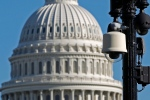 Surveillance cameras are visible near the U.S.Capitol in Washington Saturday, Oct. 26, 2013, during a rally to protest against the National Security Agency's spying on Americans, and to demand action from Congress on the NSA's mass surveillance programs. ( AP Photo/Jose Luis Magana)
