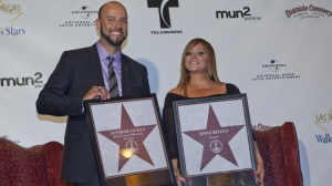 Singer Jenni Rivera and her husband, former Major League Baseball pitcher Esteban Loaiza, pose for a photograph with replicas of Las Vegas Walk of Stars Friday, July 1, 2011. (AP Photo/Julie Jacobson)