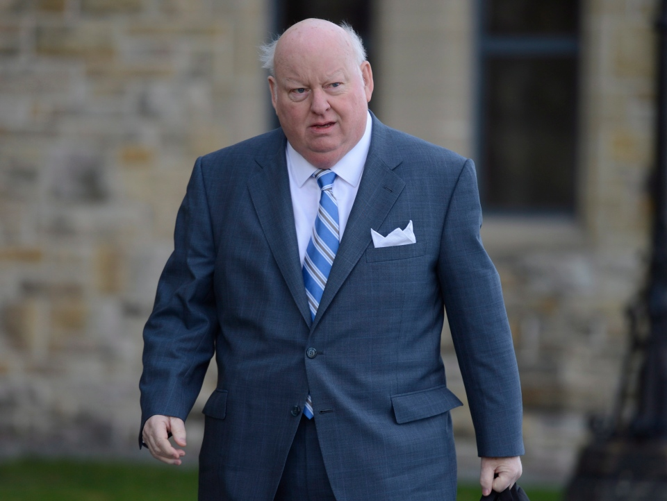 Sen. Mike Duffy arrives to the Senate on Parliament Hill in Ottawa, Monday, Oct. 28, 2013. (Adrian Wyld / THE CANADIAN PRESS)