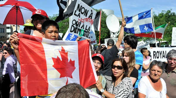 Demonstrators protest before the arrival of the Duke and Duchess of Cambridge at Montreal's Ste-Justine Children's Hospital on Saturday July 2, 2011. (Paul Chiasson / THE CANADIAN PRESS)
