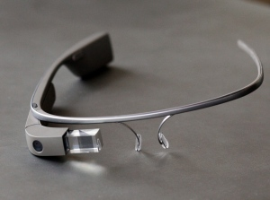 Google Glass, a device which offers video recording, photographic, and Internet access capabilities while worn like a pair of glasses, rests on a table in the offices of web development firm Whiteboard in Chattanooga, Tenn. on Friday, July 26, 2013. (AP / Doug Strickland)