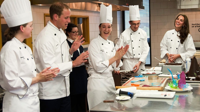 Prince William recieves a round of applause as the Duchess of Cambridge looks on during a food preparation demonstration at the Quebec Tourism and Hotel Institute in Montreal, Saturday, July 2, 2011. (Ryan Remiorz / THE CANADIAN PRESS)