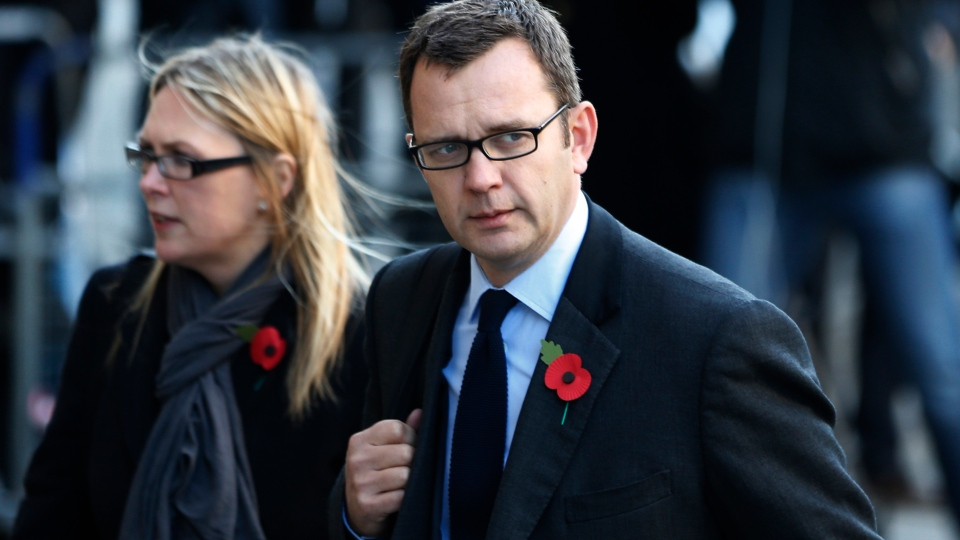Former News of the World editor Andy Coulson, right, arrives at The Old Bailey law court in London, Monday, Oct. 28, 2013. (AP / Lefteris Pitarakis)