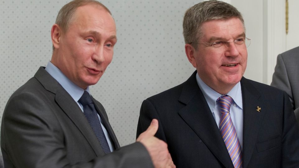Russian President Vladimir Putin, left, and International Olympic Committee President Thomas Bach meet at the Bocharov Ruchei residence at the Black Sea resort of Sochi, southern Russia, Monday, Oct. 28, 2013. (AP / Alexander Zemlianichenkol)