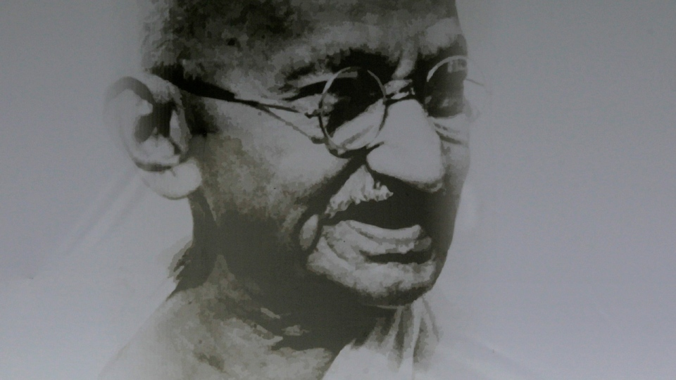 An Aug. 24, 2011 photo of a portrait of Mahatma Gandhi in New Delhi, India. (AP Photo/Manish Swarup, File)