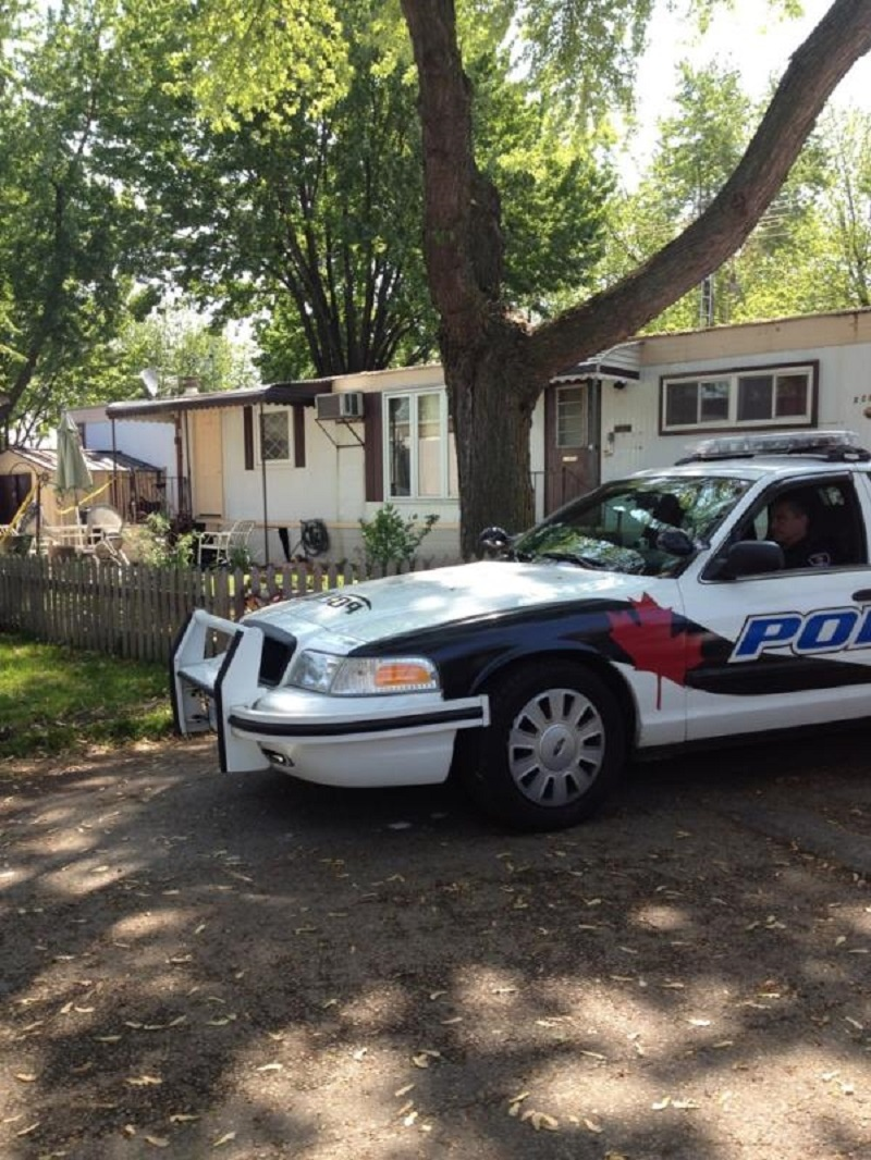 Windsor police sit outside a trailer after a man was stabbed to death on Marlin Ave in Windsor, Ont., on May 15, 2012. (Chris Campbell / CTV Windsor)