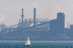 A sailing boat sails past the Stelco plant in Hamilton, Ont., in this Aug. 27, 2007 file photo, before its purchase by U.S. Steel. (The Canadian Press/Adrian Wyld)
