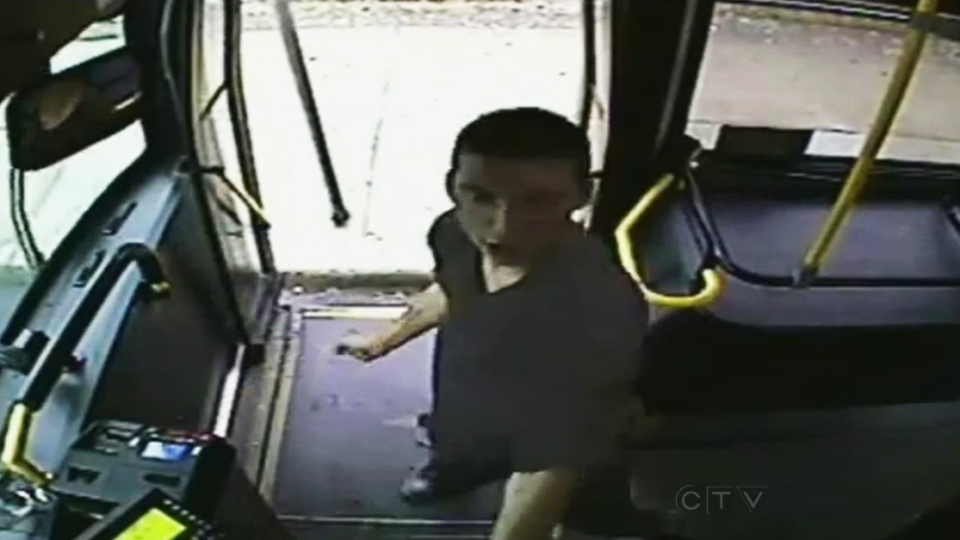 In this image taken from surveillance video, a man is seen attacking a Winnipeg city bus driver on Sept. 14, 2013. Winnipeg police released the video on Oct. 29, 2013.