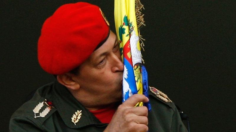 Image result for hugo chavez kissing flag