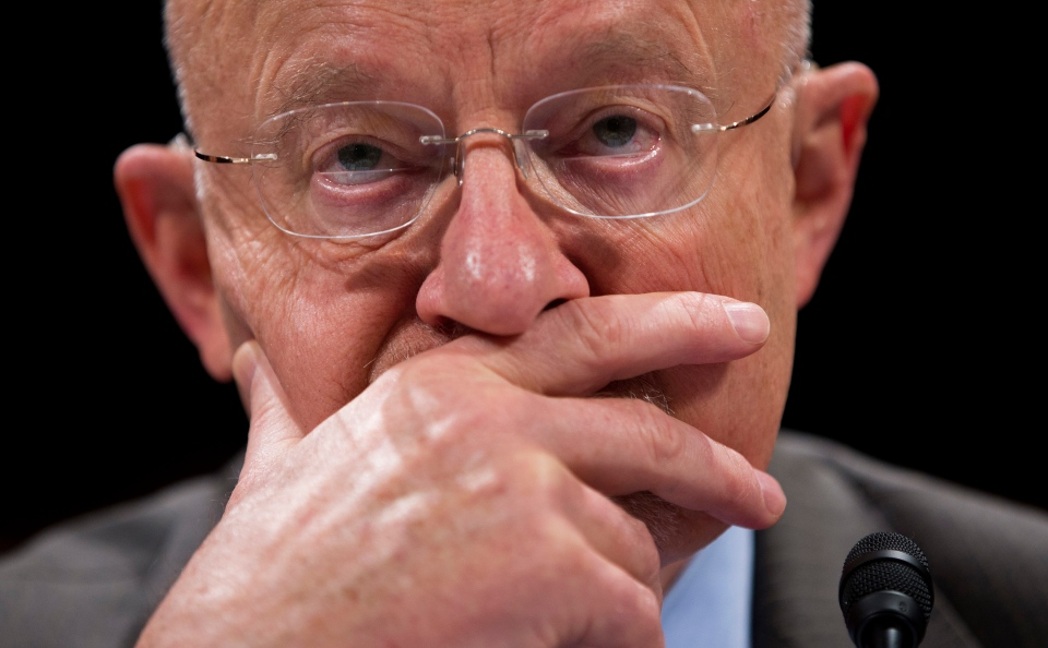 Director of National Intelligence James Clapper pauses while testifying on Capitol Hill in Washington, Tuesday, Oct. 29, 2013, before the House Intelligence Committee hearing on potential changes to the Foreign Intelligence Surveillance Act (FISA). (AP / Evan Vucci)