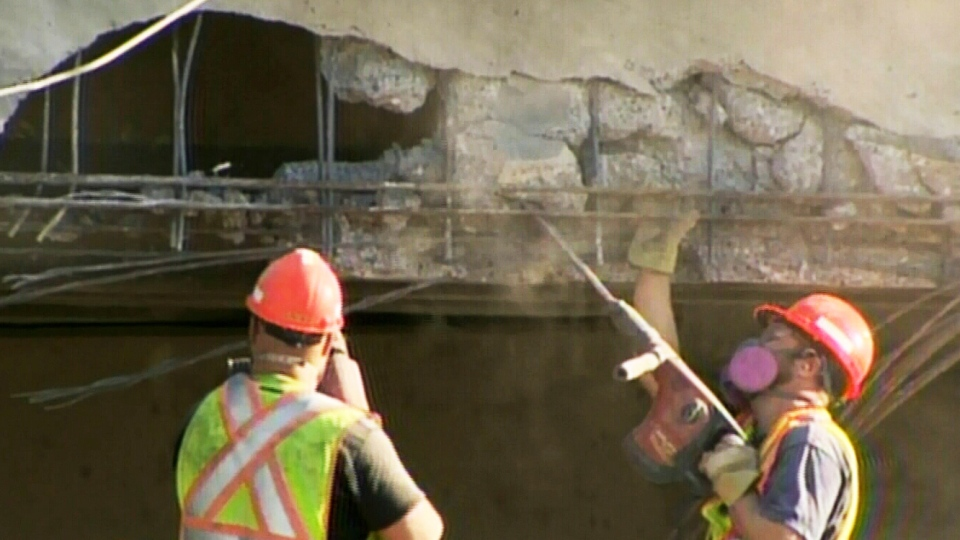 Crews inspect the Ladner Trunk Road overpass after an over-height truck crashed into it Tuesday afternoon. Oct. 29, 2013. (CTV)