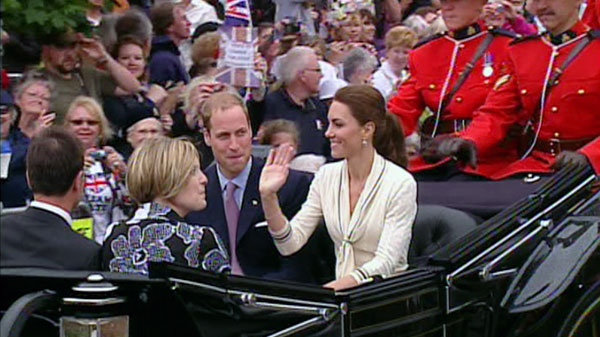 The Duke and Duchess of Cambridge wave to the crowd in P.E.I.