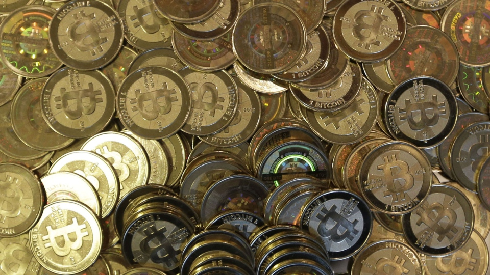 Bitcoin tokens at 35-year-old software engineer Mike Caldwell's shop in Sandy, Utah, April 3, 2013. (AP / Rick Bowmer)