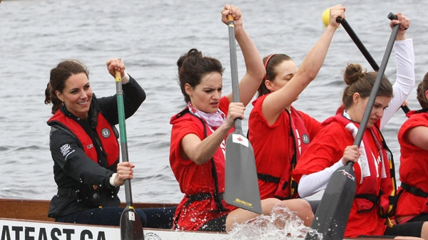 The Duchess of Cambridge, left, takes part in a dragon boat race in Dalvay Lake, P.E.I. Monday, July 4, 2011. (Ryan Remiorz / THE CANADIAN PRESS)