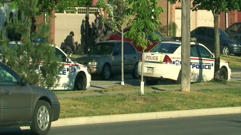 One man is dead and a two-year-old child hospitalized with serious injuries after an incident at a home in Whitby, Ont., on Monday, July 04, 2011.