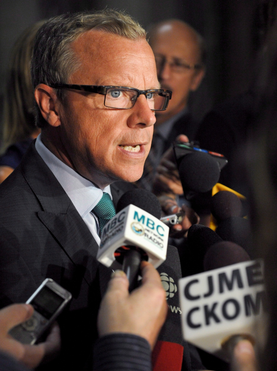 Saskatchewan Premier Brad Wall speaks to reporters in the rotunda of the Saskatchewan Legislative Building on Monday, Sept. 9, 2013 in Regina. THE CANADIAN PRESS/Michael Bell