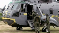 Prince William is seen boarding the helicopter for the emergency training exercise in Prince Edward Island.