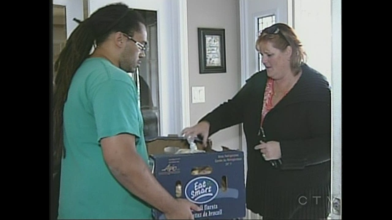 An elementary school teacher and friend of the late Yvonne Strickland, right, drops of dinner for the six Strickland siblings in London, Ont.