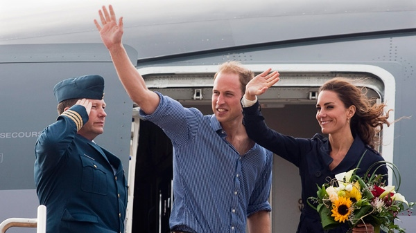 The Duke and Duchess of Cambridge wave from their aircraft as they depart Summerside, Prince Edward Island on Monday, July 4, 2011. (Andrew Vaughan / THE CANADIAN PRESS)