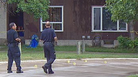 Police investigate the shooting on Taft Crescent on Monday Morning.
