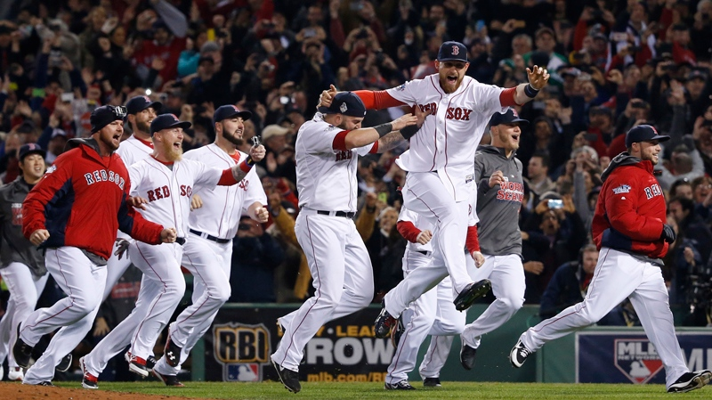 Boston Red Sox players run onto the field after defeating the St. Louis Cardinals in Game 6 of baseball's World Series Wednesday, Oct. 30, 2013, in Boston. The Red Sox won 6-1 to win the series. (AP / Elise Amendola)