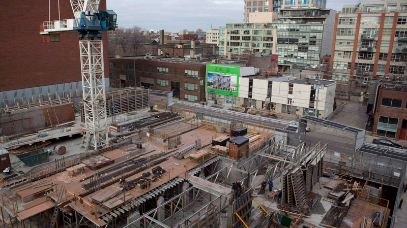 A condominium under construction is shown in Toronto in this file photo taken on Saturday, February 4, 2012. (THE CANADIAN PRESS / Pawel Dwulit)