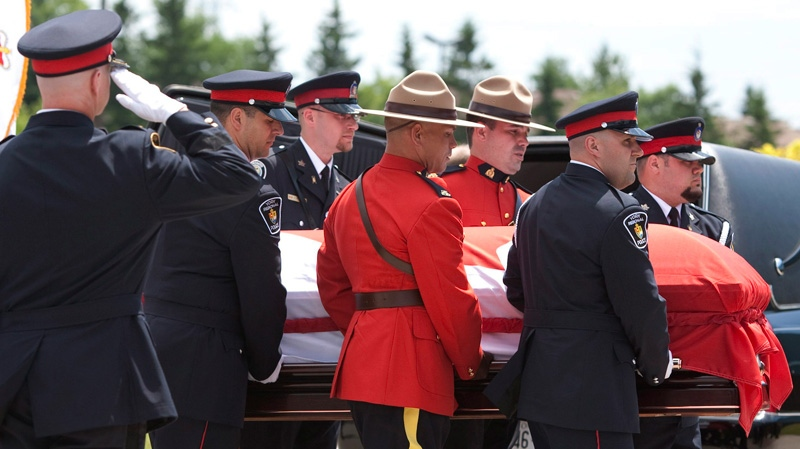 The casket of slain York Regional Police Officer Const. Garrett Styles is carried into the Ray Twinney Complex during his remembrance service in Newmarket, Ont., on Tuesday July 5, 2011. (Darren Calabrese / THE CANADIAN PRESS)
