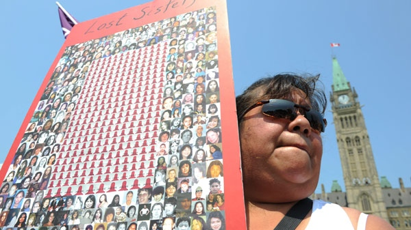 Jacqueline House of Six Nations of the Grand River territory takes part in a rally on Parliament Hill in solidarity with missing and murdered aboriginal women in Ottawa on Tuesday, July 5, 2011. THE CANADIAN PRESS/Sean Kilpatrick