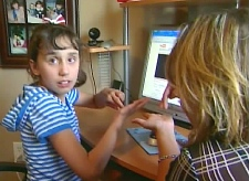 Victoria Leduc, an 11-year-old autistic student, is seen at home with her mother, Colleen Leduc.