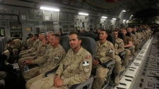 Canadian soldiers sit aboard a plane at Kandahar airbase in southern Afghanistan, on their way home, Tuesday, July 5, 2011. (AP / Rafiq Maqbool)