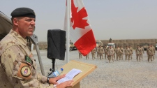 Brig.-Gen Dean Milner speaks during a ceremony marking the Canadian handover of forward fire base Masum Ghar to U.S. forces in Panjwaii district in Kandahar province southern Afghanistan, Tuesday, July 5, 2011. (AP / Rafiq Maqbool)