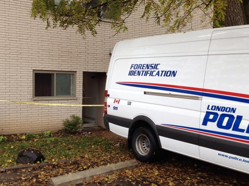 The London Police Service Forensic Identification team is at the scene where three bodies were found in an apartment on Richmond Street in London, Ont. on Thursday, Oct. 31, 2013. (Daryl Newcombe / CTV London)