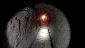 This Oct. 30, 2013 photo shows a tunnel linking warehouses in Tijuana and San Diego to smuggle drugs. The tunnel is equipped with electricity, ventilation and a rail system, U.S. authorities said. (AP Photo/U.S. Immigration and Customs Enforcement)