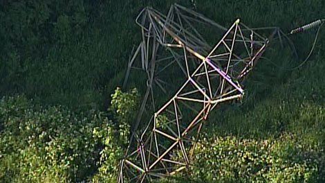 A huge hydro transmission tower toppled into the Fraser River in Surrey, B.C., on July 4, 2011. (CTV)