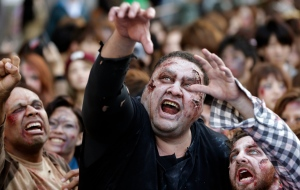 Former sumo grand champion Akebono, centre, and other participants in zombie costumes, perform during a Halloween event at Tokyo Tower in Tokyo, Thursday, Oct. 31, 2013. (AP / Shizuo Kambayashi)