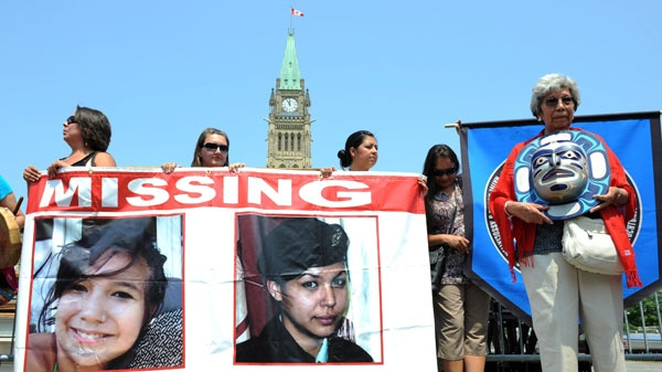 Participants of the Women's Worlds 2011 Congress take part in a rally on Parliament Hill in solidarity with missing and murdered aboriginal women in Ottawa on Tuesday, July 5, 2011. THE CANADIAN PRESS/Sean Kilpatrick