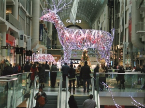 Shoppers walk by a reindeer display at the Eaton Centre in Toronto on Wednesday, Dec. 21, 2011. (The Canadian Press/Richard Buchan)