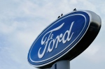 In this photo taken July 24, 2011, the Ford logo is displayed at an auto dealership in Springfield, Ill. (AP Photo/Seth Perlman)