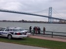 Windsor police pull a body from the Detroit River at Mill Street and Russell Street in Windsor, Ont., Friday, Nov. 1, 2013. (Chris Campbell / CTV Windsor)