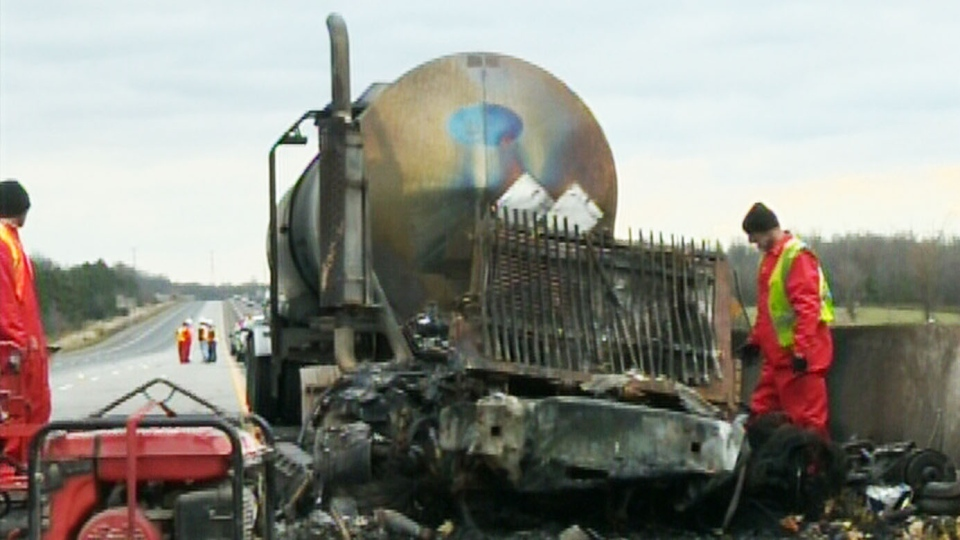 A tractor-trailor burst into flames after a multi-vehicle collision on Highway 401 near Guelph Line early Friday morning, Nov. 1, 2013.