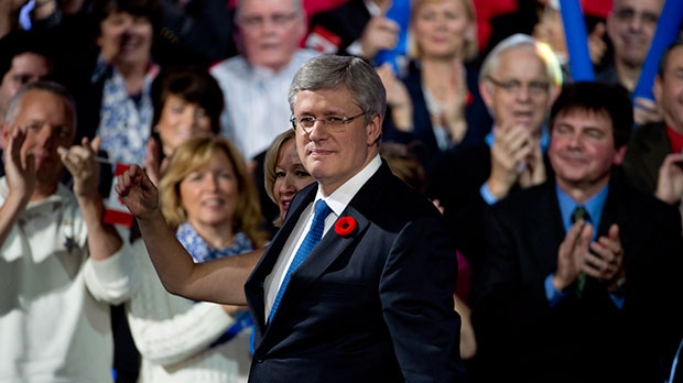 Then-prime minister Stephen Harper reacts to delegates at the Conservative convention in 2013.