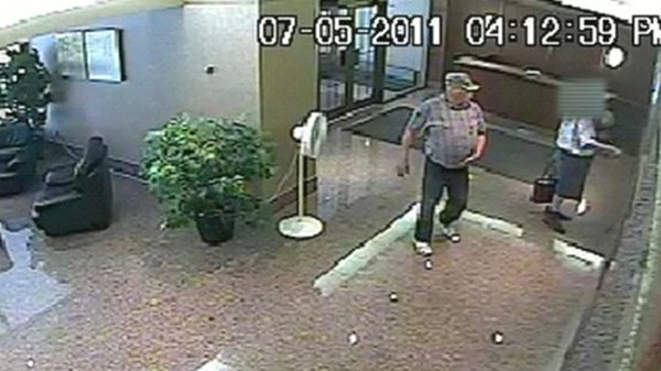 Toronto police have released security footage of a man who tells the elderly he is an undercover police officer.